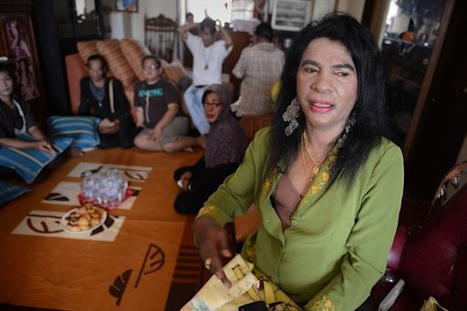 Yulianus Rettoblaut, better known as Mami Yuli, holds a meeting in her house on January 29, 2013 in the Jakarta suburbs