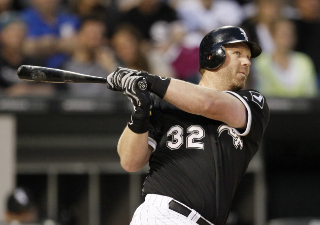 FILE - This May 11, 2012 file photo shows Chicago White Sox designated hitter Adam Dunn hitting a double off Kansas City Royals starting pitcher Felipe Paulino during the third inning of a baseball game, in Chicago. Through 36 games Dunn has more homers than he did all of last seasaon. (AP Photo/Charles Rex Arbogast, File)