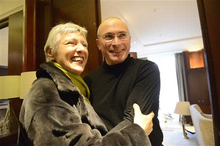 Handout photo of German politician Beck smiling next to freed Russian former oil tycoon Khodorkovsky in Berlin
