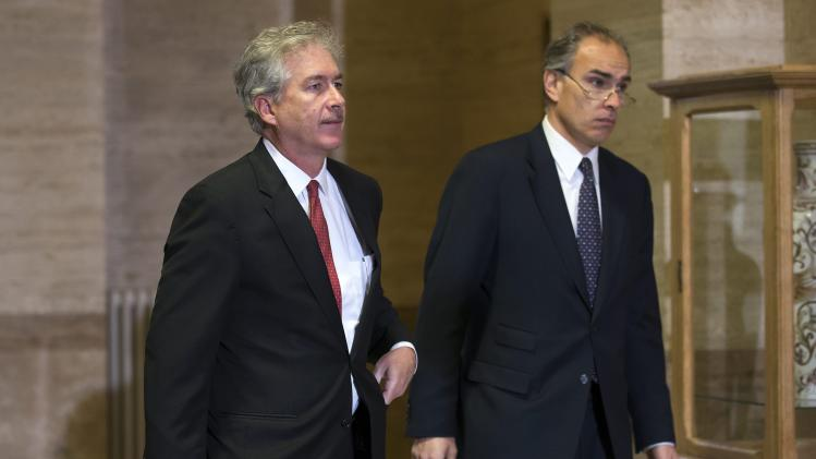United States Deputy Secretary of State William Burns, left, arrives for a meeting with UN Joint Special Representative for Syria, Lakhdar Brahimi and Russian Deputy Foreign Minister Mikhail Bogdanov, both unseen, to find a politic solution for the crisis in Syria, at the European headquarters of the United Nations, in Geneva, Switzerland, Friday, Jan. 11, 2013. (AP Photo/Keystone, Salvatore Di Nolfi)