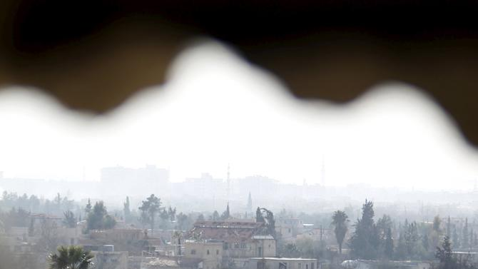 A general view shows the besieged city of Douma from Wafideen Camp, which is controlled by Syrian government forces, in Damascus suburbs, Syria