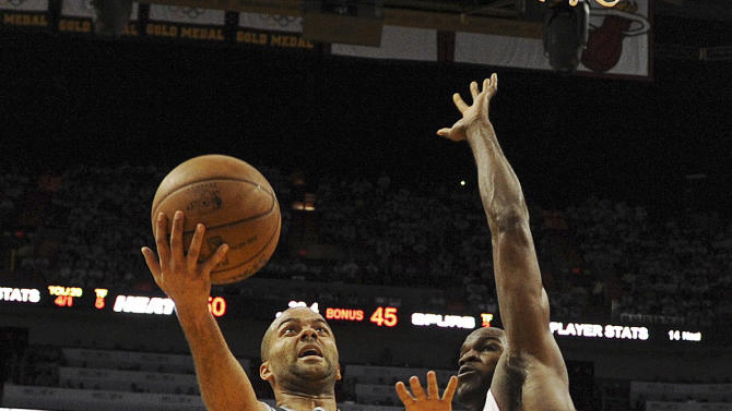 Miami Heat center Joel Anthony (50) defends against San Antonio Spurs point guard Tony Parker (9) during the first half of Game 1 of basketball's NBA Finals, Thursday, June 6, 2013 in Miami. (AP Photo/Steve Mitchell, Pool)