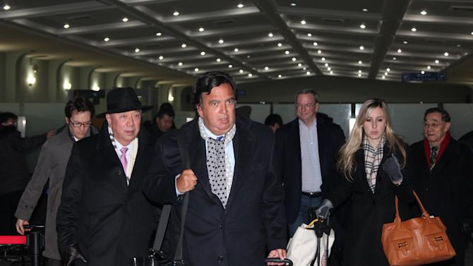 In this photo provided by China's Xinhua News Agency, former New Mexico Gov. Bill Richardson, center, and Google Executive Chairman Eric Schmidt, third right, arrive at an airport in Pyongyang, North Korea, Monday,  Jan. 7, 2013. The Google chairman wants a first-hand look at North Korea's economy and social media in his private visit Monday to the communist nation, his delegation said, despite misgivings in Washington over the timing of the trip.  (AP Photo/Xinhua, Zhang Li) NO SALES