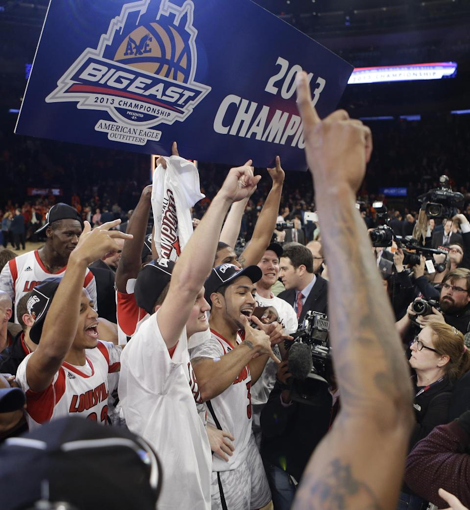 Louisville's Peyton Siva, at front of gorup, poses for photographs with teammates after an NCAA college basketball game against Syracuse for the Big East Conference men's tournament title, Saturday, March 16, 2013, in New York. Louisville won 78-61. (AP Photo/Frank Franklin II)