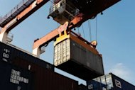 A container being loaded at Qingdao port in east China's Shandong province in August. China's manufacturing activity fell to its lowest level in more than three years in August as the global economic slowdown continues to weigh on the world's largest exporter, HSBC said