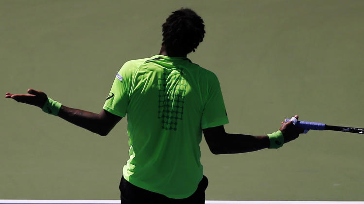 Gael Monfils, of France, reacts after a shot to Alejandro Gonzalez, of Colombia, during the second round of the 2014 U.S. Open tennis tournament, Friday, Aug. 29, 2014, in New York. (AP Photo/Elise Amendola)