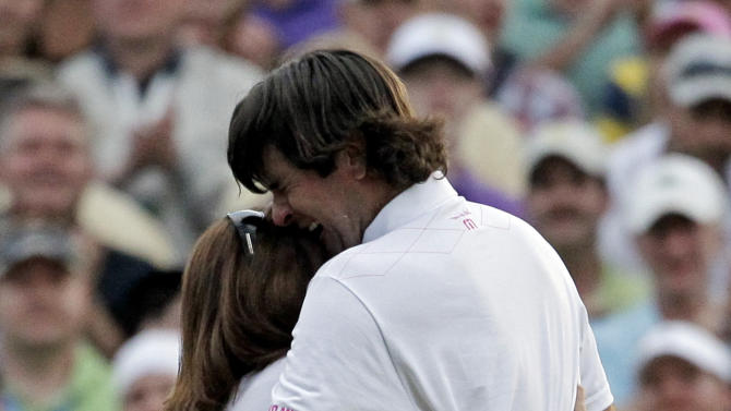 Bubba Watson hugs his mother Mollie after winning the Masters golf tournament following a sudden death playoff on the 10th hole Sunday, April 8, 2012, in Augusta, Ga.  (AP Photo/Chris O'Meara)