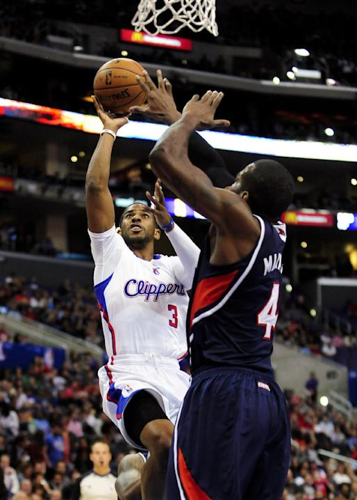 Los Angeles Clippers guard Chris Paul (3) shoots over Atlanta Hawks forward Paul Millsap (4) in the first half of an NBA basketball game, Saturday, March 8, 2014, in Los Angeles