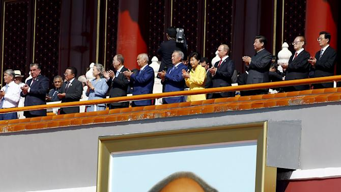 China's President Xi claps next to Russia's President Putin, South Korea's President Park, former Chinese President Jiang and former Chinese President Hu on the Tiananmen Gate, at the beginning of the military parade marking the 70th anniversary of the end