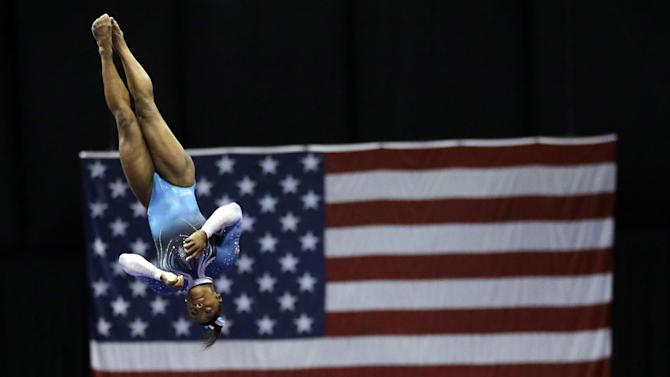 Simone Biles competes in the vault during the U.S. women's gymnastics championships Sunday, June 26, 2016, in St. Louis. (AP Photo/Jeff Roberson)
