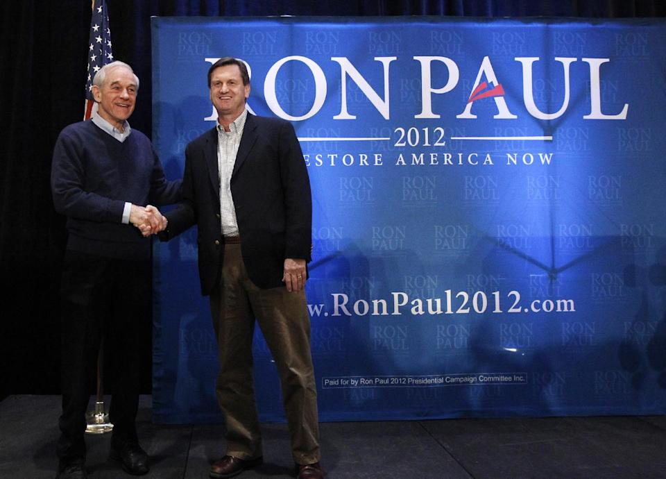 Republican presidential candidate, Rep. Ron Paul, R-Texas, is endorsed by South Carolina State Senator Tom Davis as he campaigns in Myrtle Beach, S.C., Sunday, Jan. 15, 2012. (AP Photo/Charles Dharapak)