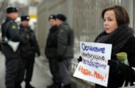 One of the supporters of a female Russian punk band Pussy Riot holds a poster as she pickets outside a Moscow courthouse. Russia has refused to free from pre-trial detention two members of female opposition punk rock group Pussy Riot who face up to seven years in jail for performing in a church