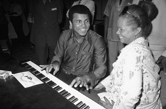 In this Sept. 22,  1974, photo, Muhammad Ali plays a few notes on the piano as singer Etta James looks on.   The singer's manager says Etta James has died in Southern California.   Lupe De Leon te