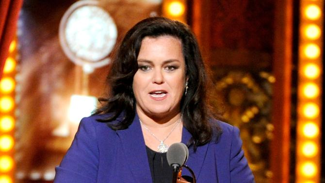 "FILE - In this June 8, 2014 file photo, Rosie O'Donnell accepts the Isabelle Stevenson Award on stage at the 68th annual Tony Awards in New York. O'Donnell isn't mincing words when it comes to Donald Trump's presidential campaign.  On Monday, Nov. 23, 2015, O'Donnell said:""It's a nightmare."" She didn't elaborate, adding only, ""That's my quote.""  (Photo by Evan Agostini/Invision/AP, File)"