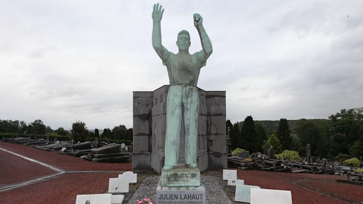 A statue of charismatic parliamentarian Julien Lahaut is pictured on top of his grave at the municipal cemetery of Seraing, eastern Belgium, Friday, Oct. 5, 2012. Now, 62 years after Belgian politician Julien Lahaut was murdered, even as the European financial crisis is squeezing budgets dry, the Belgian government has approved fresh funds to solve the crime. (AP Photo/Yves Logghe)
