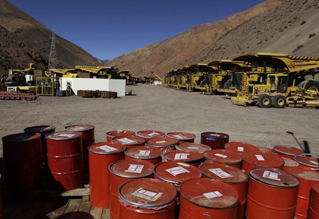 Mining machinery and barrels with chemicals sit on the facilities of Barrick Gold Corp's Pascua-Lama project in northern Chile, Thursday, May 23, 2013. Chile's environmental regulator has stopped cons