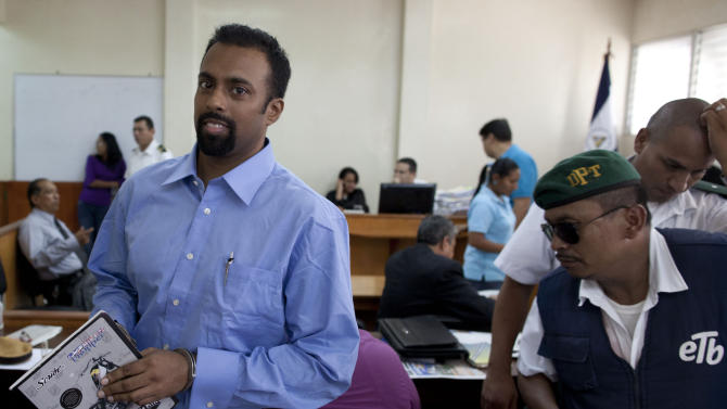 In this Aug. 20, 2012 photo, U.S citizen Jason Sachary Puracal, left, attends his appeals hearing in handcuffs in Granada, Nicaragua.  As a three-judge appellate panel mulls the 35-year-old American's fate, the case has drawn the scrutiny of U.S. lawmakers and human-rights advocates, including the California Innocence Project, which works to absolve people who have been wrongfully convicted. In late 2010 masked policemen raided his seafront real estate office and took him to Nicaragua's maximum security prison. Prosecutors charged that Puracal was using his business as a front for money laundering in a region used to transport cocaine from Colombia to the United States. Because no drugs or cash were seized, Puracal's family and friends thought he wouldn't be held long, but nine months later, a judge convicted Puracal and sentenced him to 22 years in prison. (AP Photo/Esteban Felix)