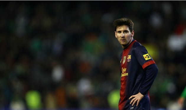 File photo of Barcelona' Messi looking on during their Spanish First Division soccer match against Real Betis in Seville