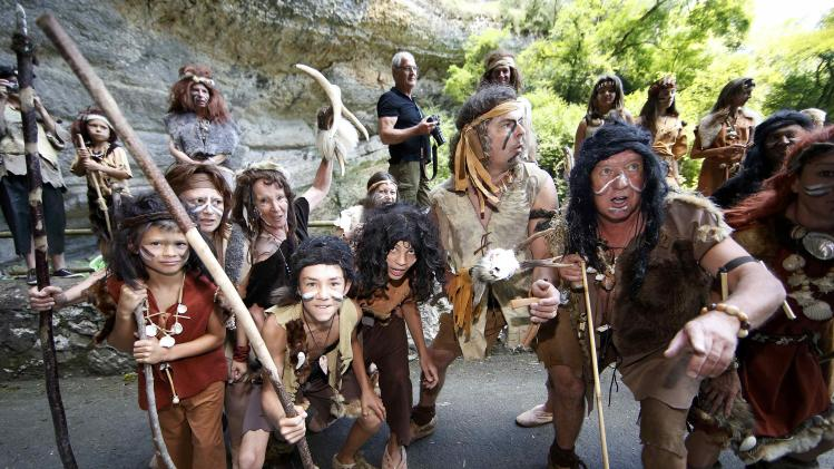 Cycling fans dressed as cavemens attend the 237.5km 16th stage of the Tour de France cycling race between Carcassonne and Bagneres-de-Luchon