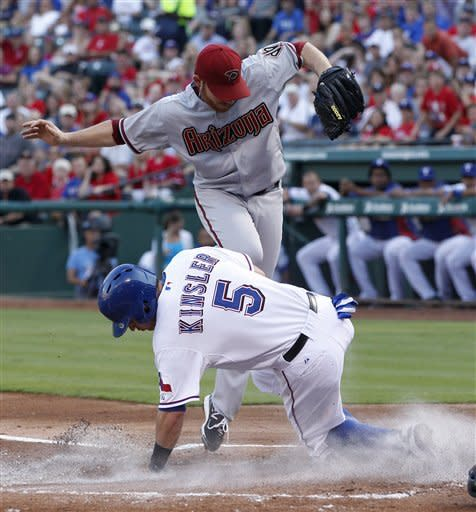 Lewis pitches 4-hitter, Rangers beat Arizona 9-1