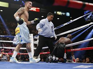 Marcos Maidana, left, from Argentina, watches after…