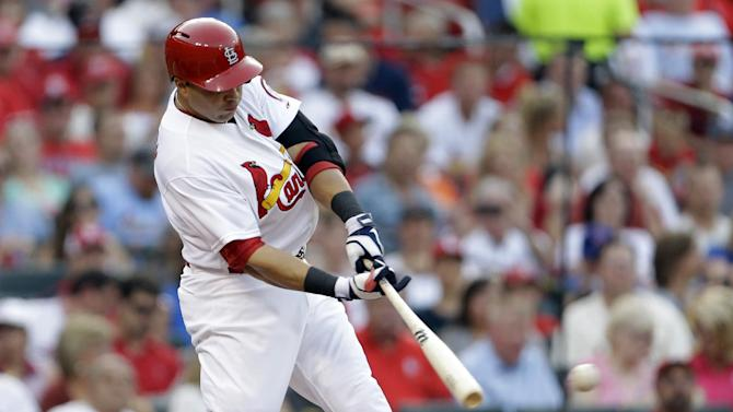 St. Louis Cardinals' Carlos Beltran hits an RBI-double during the first inning of a baseball game against the Texas Rangers, Friday, June 21, 2013, in St. Louis. (AP Photo/Jeff Roberson)