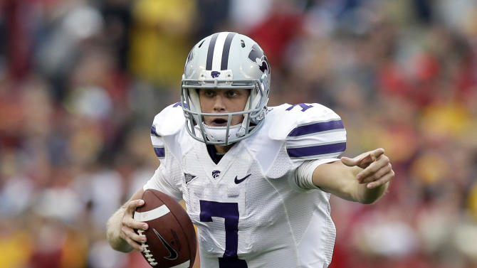 FILE - In this Oct. 13, 2012 file photo, Kansas State quarterback Collin Klein scrambles during the first half of an NCAA college football game against Iowa State in Ames, Iowa. Once the front-runner for the award, Klein will face stiff competition from Texas A&M quarterback Johnny Manziel and Notre Dame linebacker Manti Te'o when the Heisman Trophy is given out Saturday, Dec. 8, 2012, in New York. (AP Photo/Charlie Neibergall, File)