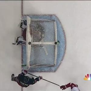 Henrik Lundqvist gets trapped under the net
