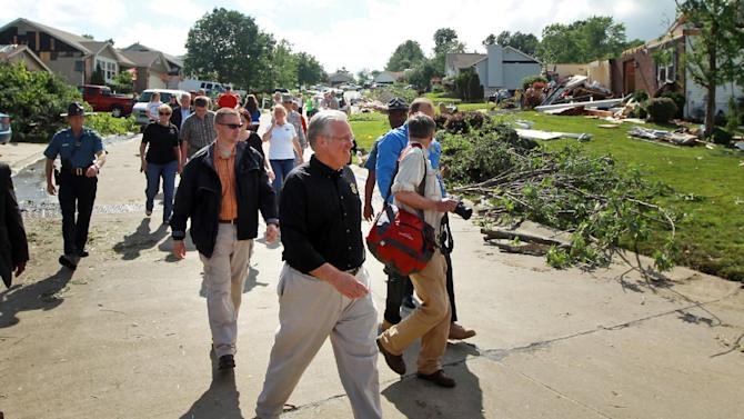 Gov. Jay Nixon tours the damage in the 900 block of Haversham Drive on Saturday, June 1, 2013 after a overnight storm in St. Charles, Mo.  (AP Photo/St. Louis Post-Dispatch, Huy Mach) EDWARDSVILLE INTELLIGENCER OUT; THE ALTON TELEGRAPH OUT