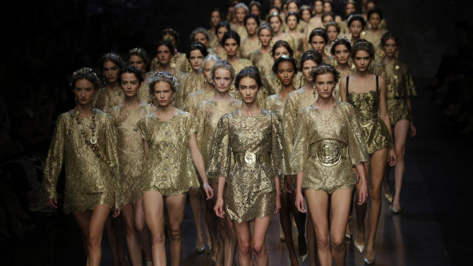 Models wear creations for Dolce & Gabbana women's Spring-Summer 2014 collection, part of the Milan Fashion Week, unveiled in Milan, Italy, Sunday, Sept. 22, 2013. (AP Photo/Luca Bruno)