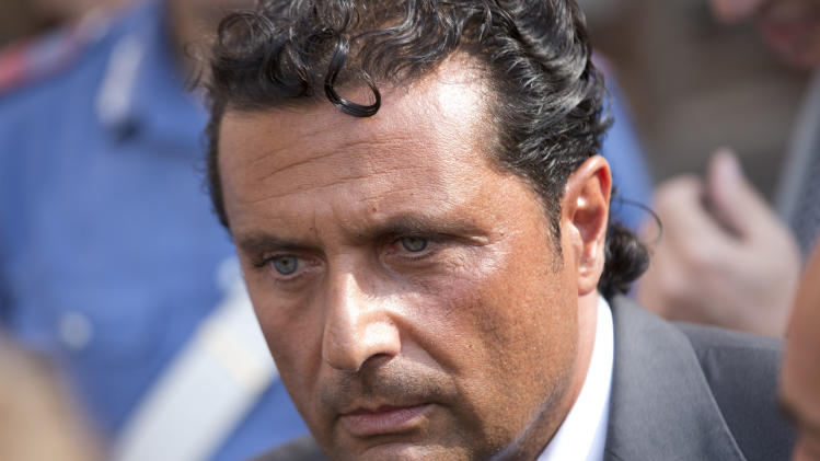 Captain Francesco Schettino leaves the court room of the converted Teatro Moderno theater at the end of a hearing of his trial, in Grosseto, Italy, Thursday, July 18, 2013. The trial of the captain of the shipwrecked Costa Concordia cruise liner, accused of multiple manslaughter, abandoning ship and causing the shipwreck near the island of Giglio, is being held in a theater converted into a courtroom in Tuscany to accommodate all the survivors and relatives of the 32 victims who want to see justice carried out in the 2012 tragedy. (AP Photo/Andrew Medichini)