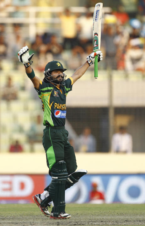 Pakistan's Fawad Alam acknowledges the crowd after scoring a century against Sri Lanka during their Asia Cup final cricket match in Dhaka, Bangladesh, Saturday, March 8, 2014. (AP Photo/A.M. Ahad)