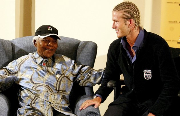 File picture shows former South African President Nelson Mandela chatting with England's soccer captain David Beckham in Johannesburg
