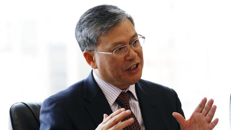 File photo of Li Fanrong, CEO of CNOOC Ltd, answering questions during an interview in Calgary