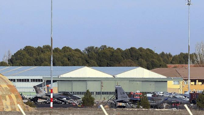 Debris and airplanes are seen at the site where a Greek F-16 fighter plane crash during NATO training, at the Albacete air base