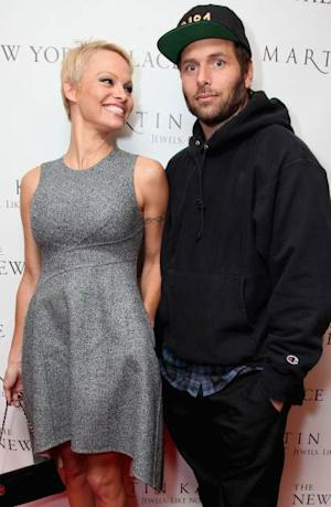 Pamela Anderson and Rick Salomon attend The Martin Katz Jewel Suite Debuts At The New York Palace Hotel on November 13, 2013 in New York City -- Getty Images