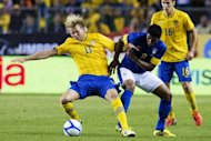 Brazil's Paulinho (R) battles for the ball with Sweden's Ola Toivonen during the friendly match at the Rasunda stadium in Solna near Stockholm on August 15, 2012. Brazil won 3-0. With Pele and other members of that team looking on, second-half replacement Alexandre Pato scored a quick-fire brace in the 84th and 87th minutes, the latter a penalty, to secure victory
