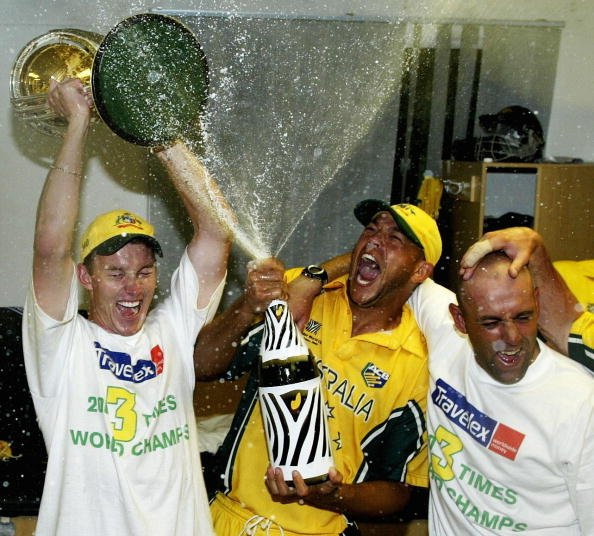 Brett Lee, Andrew Symonds and Darren Lehamann of Australia celebrate