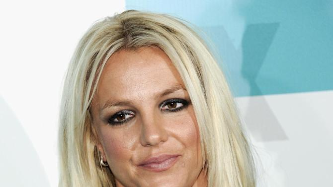 """FILE - In this May 14, 2012 file photo, new """"X Factor"""" judge Britney Spears attends the FOX network upfront presentation party at Wollman Rink, in New York. Jurors were selected in a case against the singer's parents and conservators with opening statements expected to begin Thursday Oct. 18, 2012, in Los Angeles. (AP Photo/Evan Agostini, File)"""