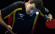 Germany's Timo Boll serves during the men's team table tennis semifinal China vs Germany of the London 2012 Olympic Games in London. Olympic champion Zhang Jike suffered a shock defeat as China survived a couple of unexpected wobbles before beating Germany 3-1 to reach the final of the men's team event on Monday