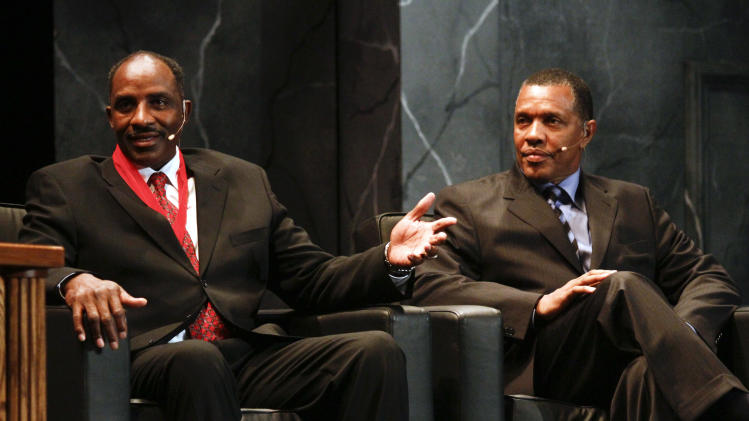 Inductee David Thompson, left, speaks as Phoenix Suns' head coach Alvin Gentry looks on during the 2010 National Collegiate Basketball Hall of Fame induction ceremony, Sunday, Nov. 21, 2010, in Kansas City, Mo. Inductees include Wayne Duke, Christian Laettner, Tom Jarnstedt, Jerry West, Tex Winter, Sidney Wicks and Davey Whitney. (AP Photo/Ed Zurga)