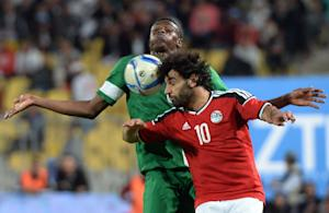 Egypt's Mohamed Saleh (front) and Nigeria's …