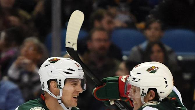 Wild snap 6-game skid in Dubnyk's debut, beat Sabres 7-0