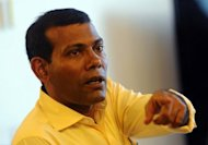 Former Maldives president Mohamed Nasheed speaks at his residence in the capital island Male on February 9. The new Maldivian government said Wednesday it would launch a probe into allegations that Nasheed was ousted from power by a military coup
