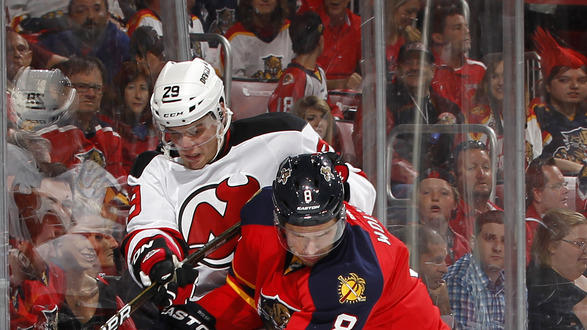 Wojtek Wolski #8 Of The Florida Panthers Checks Mark Fayne #29 Of The New Jersey Devils Off The Puck In Game One Of Getty Images