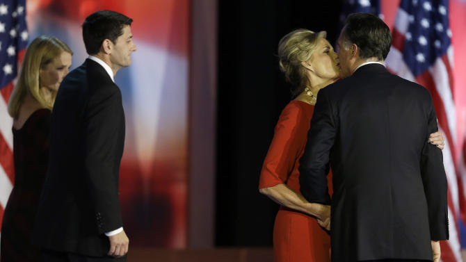 Republican presidential candidate and former Massachusetts Gov. Mitt Romney, right kisses his wife Ann Romney as Republican vice presidential candidate, Rep. Paul Ryan, R-Wis., and his wife Janna walk onto the stage at left, during Romney's election night rally, Wednesday, Nov. 7, 2012, in Boston. (AP Photo/David Goldman)