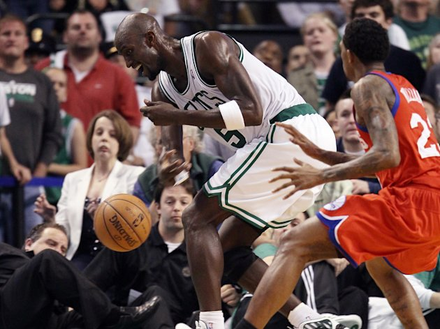 BOSTON, MA - MAY 12:  Kevin Garnett #5 of the Boston Celtics smacks the loose ball in bounds as Lou Williams #23 of the Philadelphia 76ers defends in Game One of the Western Conference Semifinals in the 2012 NBA Playoffs on May 12, 2012 at TD Garden in Boston, Massachusetts. The Boston Celtics defeated the Philadelphia 76ers 92-91. NOTE TO USER: User expressly acknowledges and agrees that, by downloading and or using this photograph, User is consenting to the terms and conditions of the Getty Images License Agreement.  (Photo by Elsa/Getty Images)