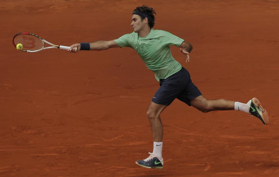 Roger Federer from Switzerland returns the ball during a match against Radek Stepanek from Czech Republic at the Madrid Open tennis tournament, in Madrid, Tuesday, May 7, 2013. (AP Photo/Andres Kudacki)
