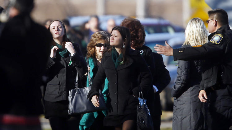 Mourners arrive for the funeral service of Victoria Soto at Lordship Community Church in Stratford, Conn., Wednesday, Dec. 19, 2012. Soto was killed when Adam Lanza forced his way into Sandy Hook Elementary School in Newtown Friday and opened fire, killing 26 people, including 20 children. (AP Photo/Jason DeCrow)