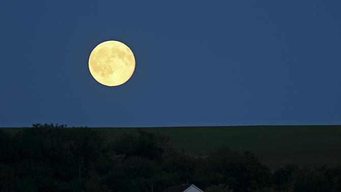 A full moon, known as the Blue Moon, is seen over Loosely Row, near Princes Risborough